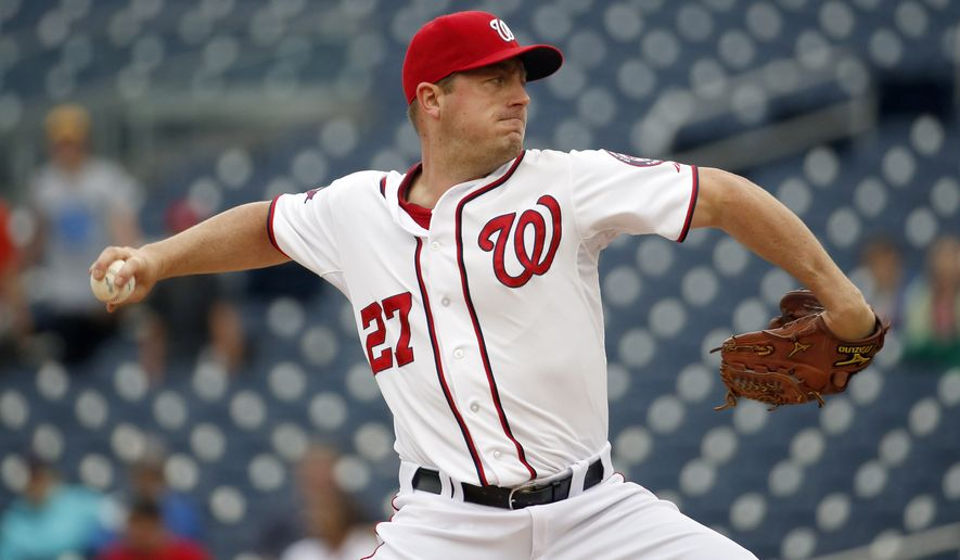 Washington Nationals starting pitcher Jordan Zimmermann (27) throws during the third inning of the first baseball game in a doubleheader against the Toronto Blue Jays, Tuesday, June 2, 2015, in Washington. (AP Photo/Alex Brandon)