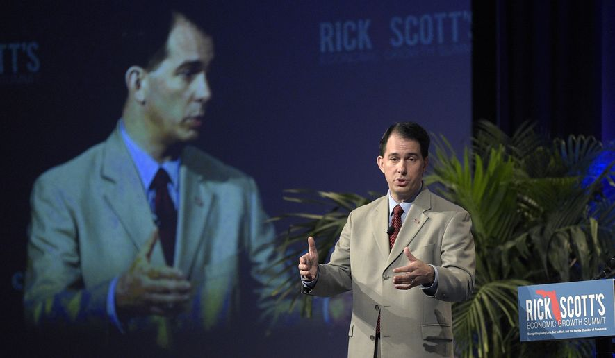 Wisconsin Gov. Scott Walker speaks during Rick Scott's Economic Growth Summit in Lake Buena Vista, Fla., Tuesday, June 2, 2015. (AP Photo/Phelan M. Ebenhack)