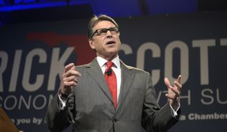 Former Texas Gov. Rick Perry speaks during Rick Scott's Economic Growth Summit in Lake Buena Vista, Fla., Tuesday, June 2, 2015. (AP Photo/Phelan M. Ebenhack)