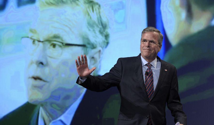 Former Florida Gov. Jeb Bush waves while walking on the stage to speak at Rick Scott's Economic Growth Summit in Lake Buena Vista, Fla., Tuesday, June 2, 2015. (AP Photo/Phelan M. Ebenhack)