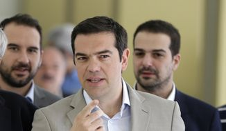 Greece's Prime Minister Alexis Tsipras arrives for a meeting at the Education Ministry in Athens, Tuesday, June 2, 2015. Tsipras says Greece has submitted a proposal for an agreement with its creditors, as Athens seeks a deal that will to unlock desperately needed rescue money. (AP Photo/Thanassis Stavrakis)