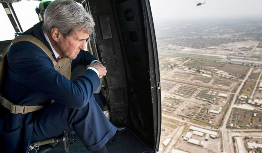 U.S. Secretary of State John Kerry surveys Baghdad, Iraq from a helicopter on Sept. 10, 2014. (Associated Press) ** FILE **