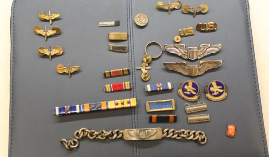 This undated photo provided by the Gwinnett County Police Department shows WWII memorabilia stolen from an unidentified man during a burglary in March.  Metro Atlanta sheriff's officials say the man was reunited with the memorabilia, which belonged to his late grandfather, on Monday, June 1, 2015. (AP Photo/Gwinnett County Police Department)