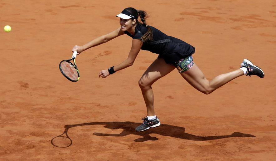 Serbia's Ana Ivanovic returns the ball to Ukraine's Elina Svitolina during their quarterfinal match of the French Open tennis tournament at the Roland Garros stadium, Tuesday, June 2, 2015 in Paris, France. (AP Photo/Thibault Camus)