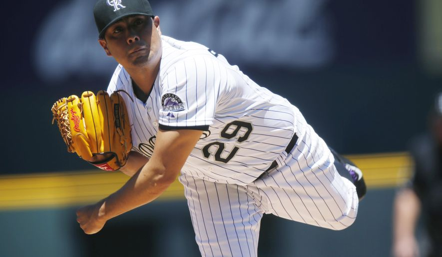 Colorado Rockies starting pitcher Jorge De La Rosa works against the Los Angeles Dodgers during the first inning of game one in a baseball doubleheader, Tuesday, June 2, 2015, in Denver. (AP Photo/David Zalubowski)