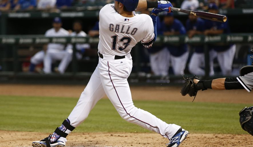 Texas Rangers' Joey Gallo follows through for a double against the Chicago White Sox during the fifth inning of a baseball game, Tuesday, June 2, 2015, in Arlington, Texas. (AP Photo/Jim Cowsert)