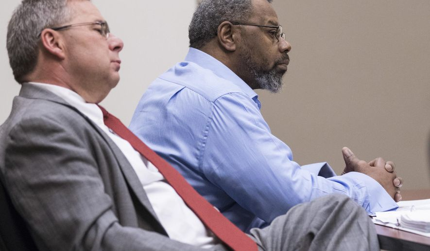 Aurelias Marshall sits in court with his attorney Charles Clapp during his trial, Tuesday, June 2, 2015 at the Kent County Courthouse in Grand Rapids, Mich. Aurelias Marshall faces life in prison if convicted of first-degree murder. Twenty-five years later, a trial has opened in the death of a young man who was killed while walking home from a Grand Rapids bar. (Hugh Carey/The Grand Rapids Press via AP) ALL LOCAL TELEVISION OUT; LOCAL TELEVISION INTERNET OUT