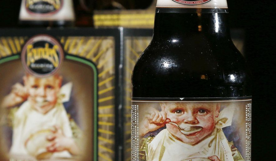 FILE - In this  Jan. 15, 2015 file photo, bottles of founders Brewing Breakfast Stout are displayed in North Andover, Mass. New Hampshire Gov. Maggie Hassan on Tuesday, June 2, 2015, vetoed a measure that would have allowed some images of minors to grace alcoholic beverage labels in the state as long as they didn't encourage young people to drink. State Rep. Keith Murphy, who runs a popular tavern, sponsored the bill because he wanted to be able to buy Breakfast Stout, crafted by Founders Brewery Co. in Grand Rapids, Mich. (AP Photo/Elise Amendola, File)