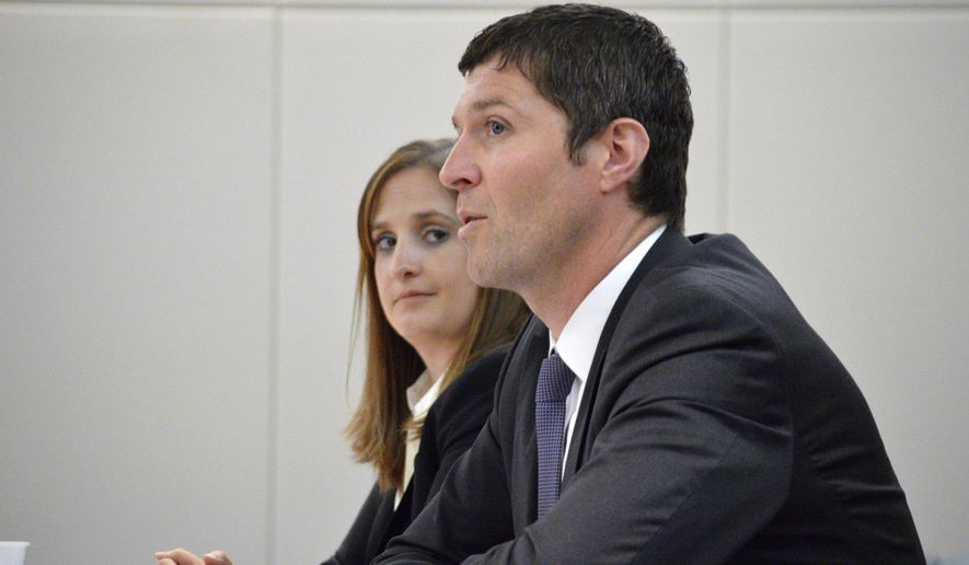 New Mexico Environment Department Secretary Ryan Flynn, right, and Resource Protection Division head Katie Roberts, left, speak before the state Legislative Radioactive and Hazardous Material Committee on Tuesday, June 2, 2015 in Santa Fe, N.M. Flynn announced that workers have finished sealing off storage bunkers affected by a radiation leak at the federal government's underground nuclear waste repository in southern New Mexico. (AP Photo/Russell Contreras)