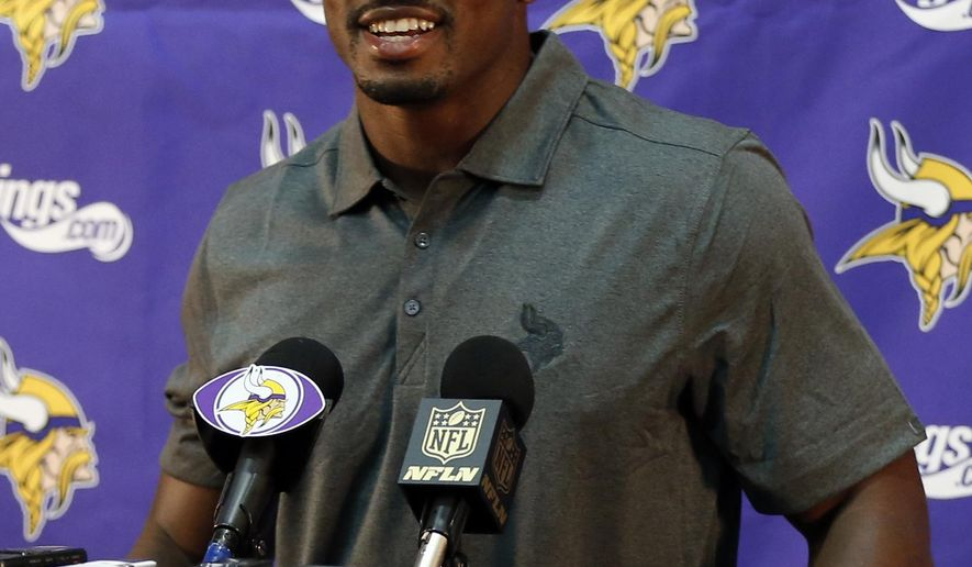 Minnesota Vikings running back Adrian Peterson greets the media at the team's NFL football Winter Park headquarters, Tuesday, June 2, 2015 in Eden Prairie, Minn., after he took part in voluntary practice after nine months away. Peterson missed the final 15 games of last season while addressing child abuse charges in Texas. (AP Photo/Jim Mone)
