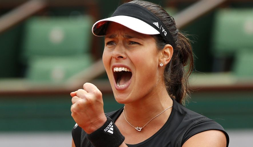 Serbia's Ana Ivanovic clenches her fist as she plays Ukraine's Elina Svitolina during their quarterfinal match of the French Open tennis tournament at the Roland Garros stadium, Tuesday, June 2, 2015 in Paris, France. (AP Photo/Michel Euler)