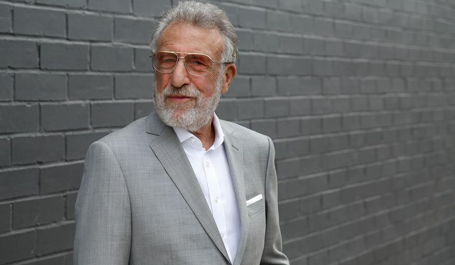 This undated photo provided by zTailors shows company chairman and Men's Wearhouse founder George Zimmer. Zimmer, who was ousted from Men's Wearhouse two years ago, launched zTailors this week, a company that sends clothing tailors to homes or offices. (zTailors via AP)