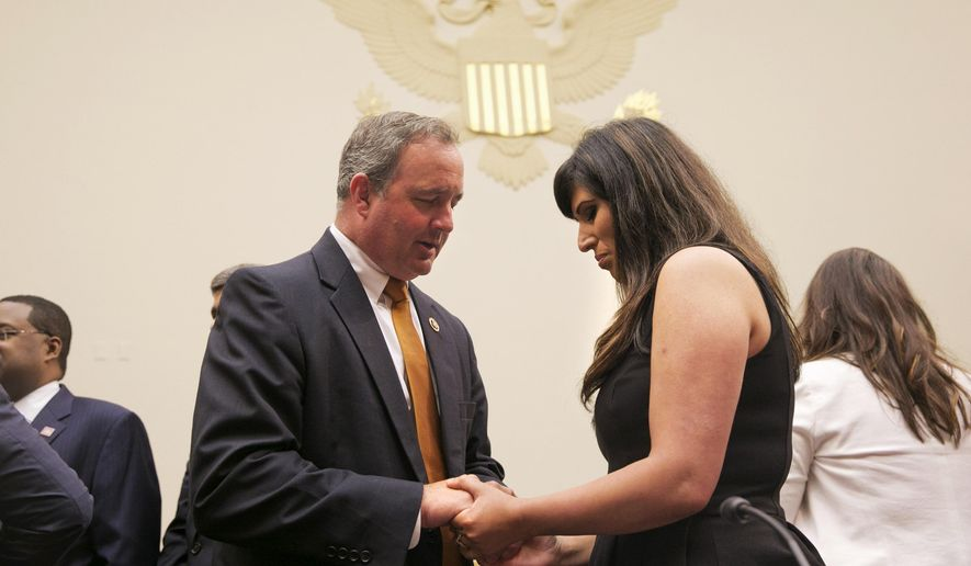 Naghmeh Abedini, wife of U.S. citizen Saeed Abedini, right, who is being held in Iran, prays with Rep. Jeff Duncan, R-S.C., on Capitol Hill in Washington, Tuesday, June 2, 2015, prior to a House Foreign Affairs Committee hearing with testimony from four people whose family members are being held in Iran. (AP Photo/Jacquelyn Martin)
