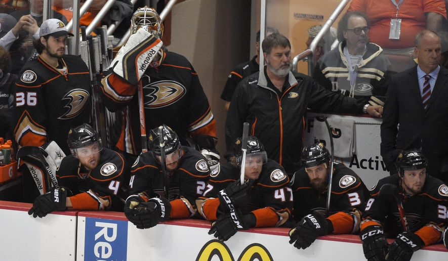 Members of the Anaheim Ducks their to their loss against the Chicago Blackhawks in Game 7 of the Western Conference final of the NHL hockey Stanley Cup playoffs in Anaheim, Calif., Saturday, May 30, 2015. The Blackhawks won 5-3 to advance to Stanley Cup Finals. (AP Photo/Mark J. Terrill)