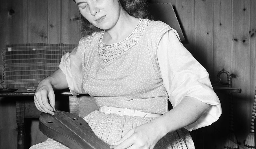 FILE - This July 15, 1950 file photo shows folksinger Jean Ritchie. Ritchie, the Kentucky-born folksinger who brought the centuries-old ballads she grew up with to a wide audience from the 1950s onward, died Monday, June 1, 2015, in her home in Berea, Kentucky, with family around her, her niece Judy Hudson said. She was 92. (AP Photo/File)