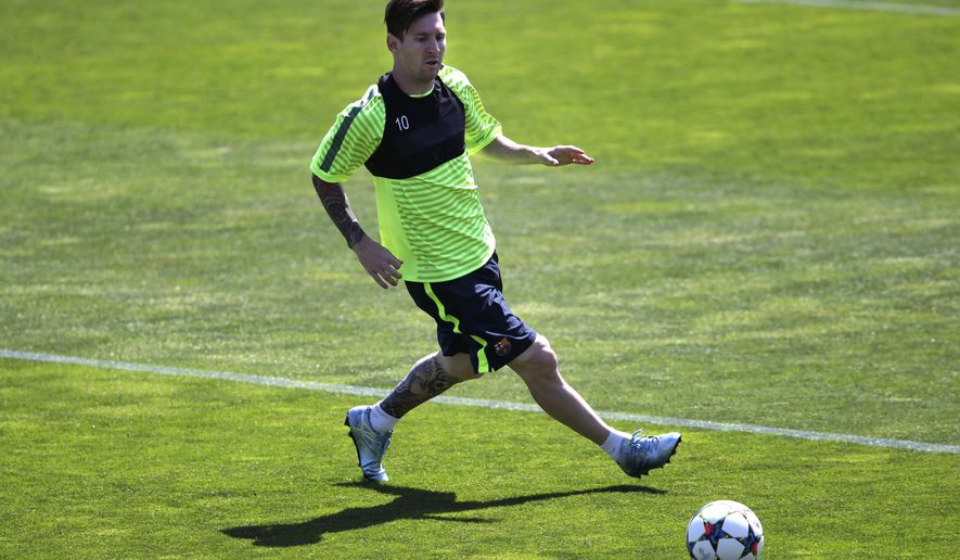 Barcelona's Lionel Messi runs with the ball during a training session ahead of Saturday's Champions League final soccer match against Juventus, in Barcelona, Spain, Tuesday, June 2, 2015 (AP Photo/Emilio Morenatti)