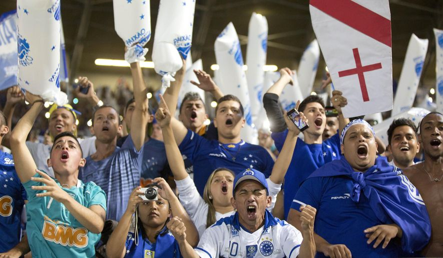 In this Wednesday, May 27, 2015 photo, Brazil's Cruzeiro fans cheer prior to a Copa Libertadores quarter finals soccer match against Argentina's River Plate in Belo Horizonte, Brazil. (AP Photo/Andre Penner)