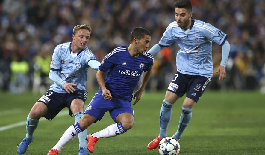 Chelsea F.C. player Eden Hazard, center, is chased down by Sydney FC's Christopher Naumoff, right, and Rhyan Grant during their club friendly soccer match in Sydney Tuesday, June 2, 2015. (AP Photo/Rob Griffith)