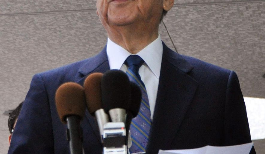 Gov. of Okinawa Takeshi Onaga answers to a reporter's question after his meeting with U.S. officials in Washington Wednesday, June 3, 2015. State and Defense department officials told him that there is no alternative but to build an airfield for the Marines on his southern Japanese island. (Kyodo News via AP) JAPAN OUT, MANDATORY CREDIT