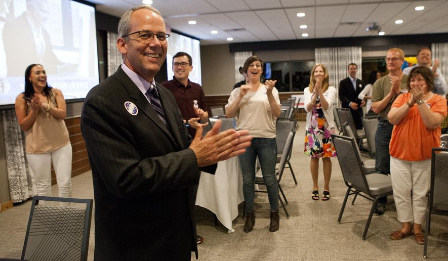 Retired Rapid City, S.D. police chief Steve Allender applauds with his supporters after winning the Rapid City mayoral race against Sam Kooiker Tuesday, June 2, 2015 at his election party at the Adoba Eco Hotel in Rapid City. (Josh Morgan/Rapid City Journal via AP) TV OUT