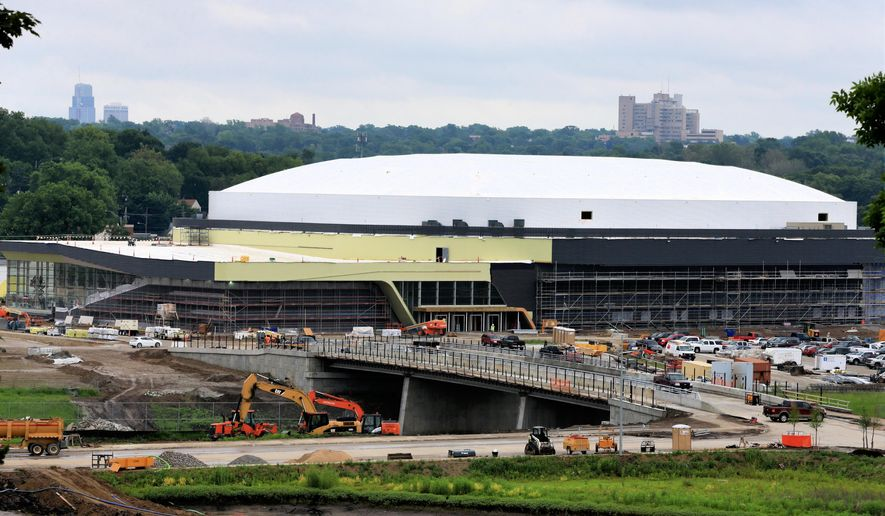 The new University of Nebraska at Omaha arena is under construction in Omaha, Neb., Wednesday, June 3, 2015.  Omaha-based Baxter Auto is paying $4 million over 10 years for naming rights. The 7,500-seat facility will be called Baxter Arena. (AP Photo/Nati Harnik)