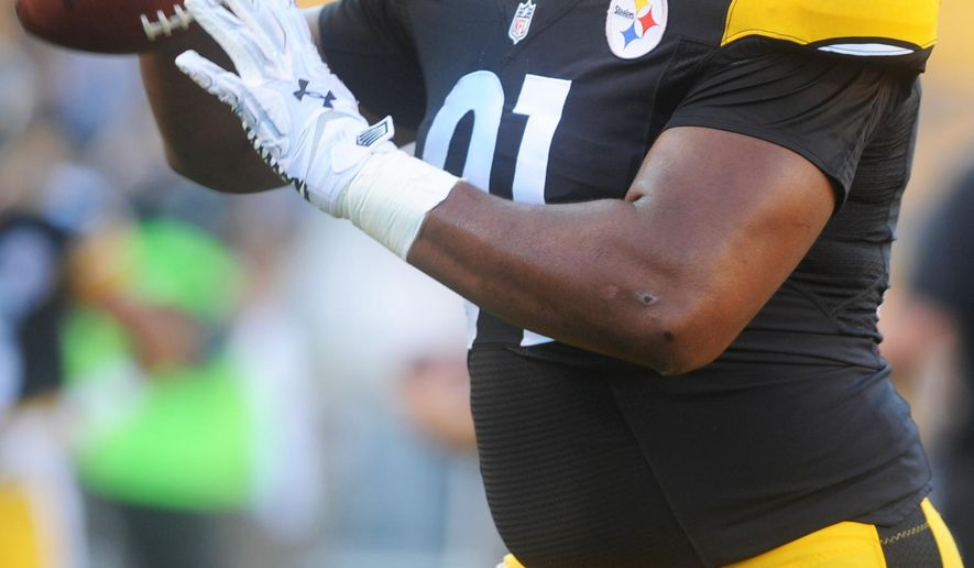 FILE - In this Aug. 16, 2014, file photo, Pittsburgh Steelers defensive tackle Stephon Tuitt (91) tosses a football during warm ups before an NFL preseason football game against the Buffalo Bills in Pittsburgh. The Steelers are banking on Tuitt's learning curve accelerating after they cut Brett Keisel and made no moves to improve a defensive line that struggled at times last season. (AP Photo/Vincent Pugliese, File)