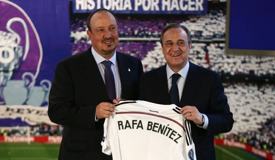 New Real Madrid coach Rafael Benitez, left, and Real Madrid's President Florentino Perez, right,  pose for a picture during his official presentation at the Santiago Bernabeu stadium in Madrid, Spain, Wednesday, June 3, 2015, after signing for Real Madrid. (AP Photo/Andres Kudacki)