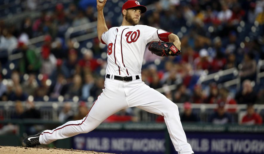 Washington Nationals starting pitcher Taylor Jordan throws during the third inning of a baseball game against the Toronto Blue Jays at Nationals Park, Wednesday, June 3, 2015, in Washington. (AP Photo/Alex Brandon)