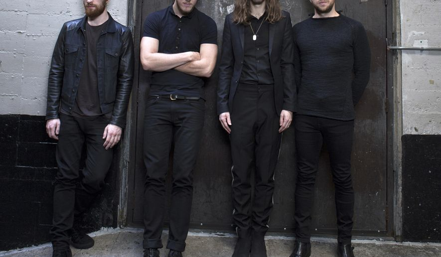 FILE - In this Feb. 5, 2015 file photo, Dan Platzman, from left, Dan Reynolds, Daniel Wayne Sermon and Ben McKee of Imagine Dragons pose for a portrait at the Mayan Theater in Los Angeles. The band will launch their second headlining Smoke + Mirrors Tour this week. (Photo by Rebecca Cabage/Invision/AP, File)