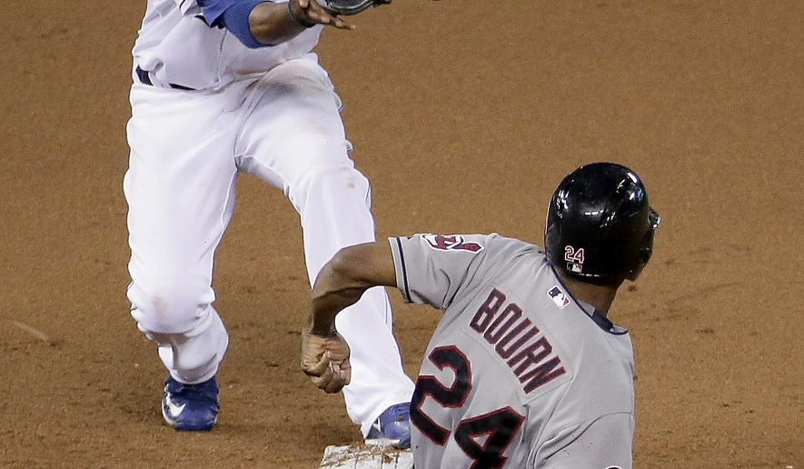 Kansas City Royals shortstop Alcides Escobar forces Cleveland Indians' Michael Bourn (24) out at second on a ball hit Mike Aviles to end the top of the seventh inning of a baseball game Wednesday, June 3, 2015, in Kansas City, Mo. (AP Photo/Charlie Riedel)