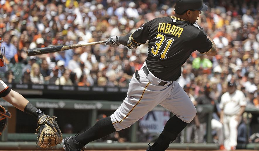 Pittsburgh Pirates' Jose Tabata hits an RBI single off San Francisco Giants starting pitcher Tim Hudson in the third inning of their baseball game Wednesday, June 3, 2015, in San Francisco. (AP Photo/Eric Risberg)