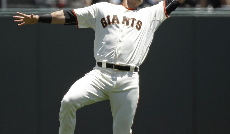 San Francisco Giants second baseman Joe Panik catches a fly ball hit by the Pittsburgh Pirates' Andrew McCutchen in the first inning of their baseball game Wednesday, June 3, 2015, in San Francisco. (AP Photo/Eric Risberg)