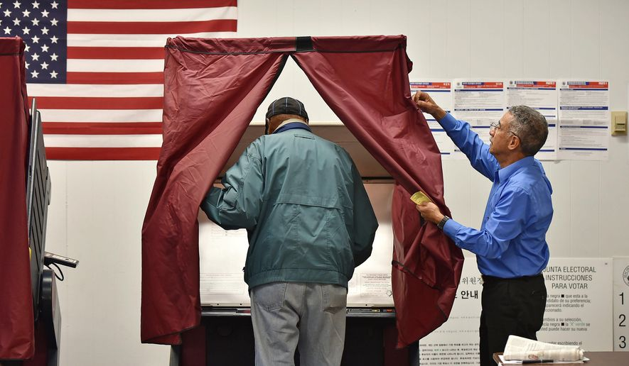Englewood resident William Hurt, 83, enters a voting machine as board worker Fernando Rosario opens the curtain at the polls in the Democratic primary, Tuesday, June 2, 2015, at Liberty School in Englewood, N.J. (Mitsu Yasukawa/The Record of Bergen County via AP)