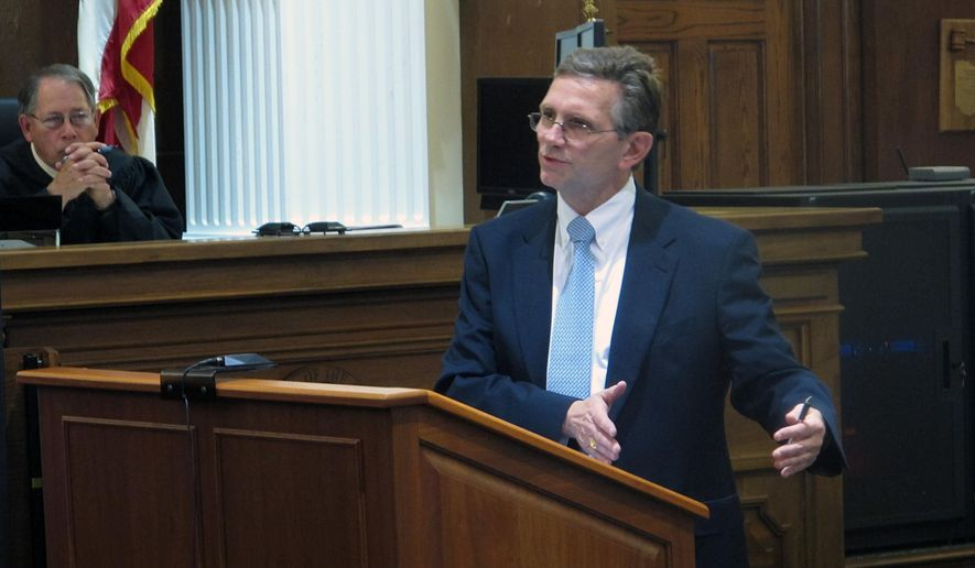 FILE - In this Monday, May 11, 2015, file photo, defense attorney George Leach, right, defends his client against Union County charges of sexually assaulting three adopted daughters and his stepdaughter, as Judge David Faulkner observes, in Marysville, Ohio. The accused, an Ohio National guardsman, was convicted and is scheduled to be sentenced Wednesday, June 3, 2015. (AP Photo/Andrew Welsh-Huggins, File)