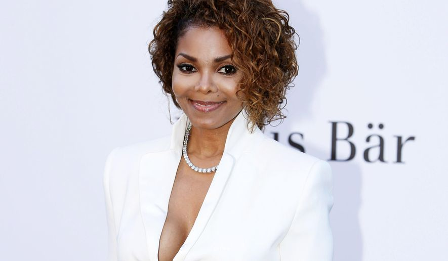 FILE - In this May 23, 2013 file photo, singer Janet Jackson arrives at amfAR Cinema Against AIDS benefit at the Hotel du Cap-Eden-Roc, during the 66th international film festival, in Cap d'Antibes, southern France. Janet Jackson is releasing her first album in seven years this fall. The pop icon said on her website Wednesday, June 3, 2015, that the album, not yet titled, will be released on her own label, Rhythm Nation Records, via Bertelsmann Music Group. (Photo by Joel Ryan/Invision/AP, File)