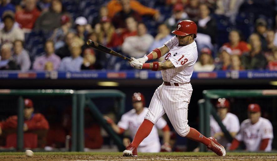 Philadelphia Phillies' Freddy Galvis follows through after driving in the game-winning run on a fielding error by Cincinnati Reds relief pitcher Ryan Mattheus during the 11th inning of a baseball game, Wednesday, June 3, 2015, in Philadelphia. Philadelphia won 5-4 in 11 innings. (AP Photo/Matt Slocum)