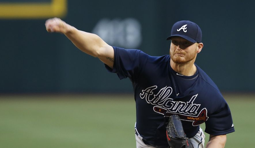 Atlanta Braves pitcher Shelby Miller throws in the first inning during a baseball game against the Arizona Diamondbacks, Tuesday, June 2, 2015, in Phoenix. (AP Photo/Rick Scuteri)