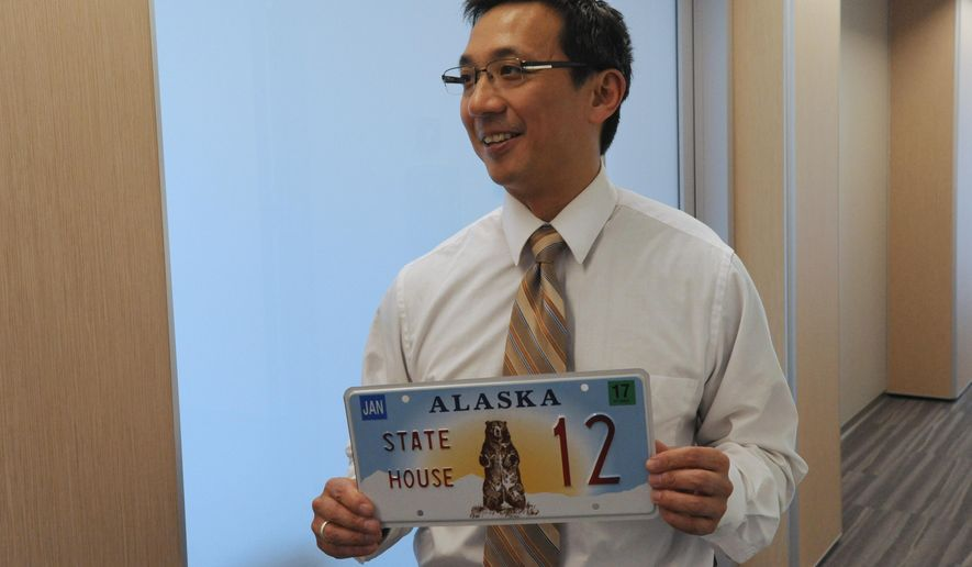 Rep. Scott Kawasaki, D-Fairbanks, stands with his new legislative plate inside the Legislative Information Office building during a special session in Anchorage on Monday, June 1, 2015.  (Bill Roth  /Alaska Dispatch News via AP)  KTUU-TV OUT; KTVA-TV OUT; THE MAT-SU VALLEY FRONTIERSMAN OUT; MANDATORY CREDIT