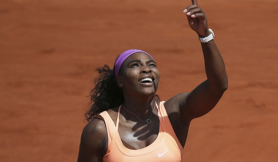 Serena Williams of the U.S. gestures she has trouble returning a high ball against the sunlight in the quarterfinal match of the French Open tennis tournament against Italy's Sara Errani at the Roland Garros stadium, in Paris, France, Wednesday, June 3, 2015. Williams won in two sets 6-1, 6-3, (AP Photo/David Vincent)