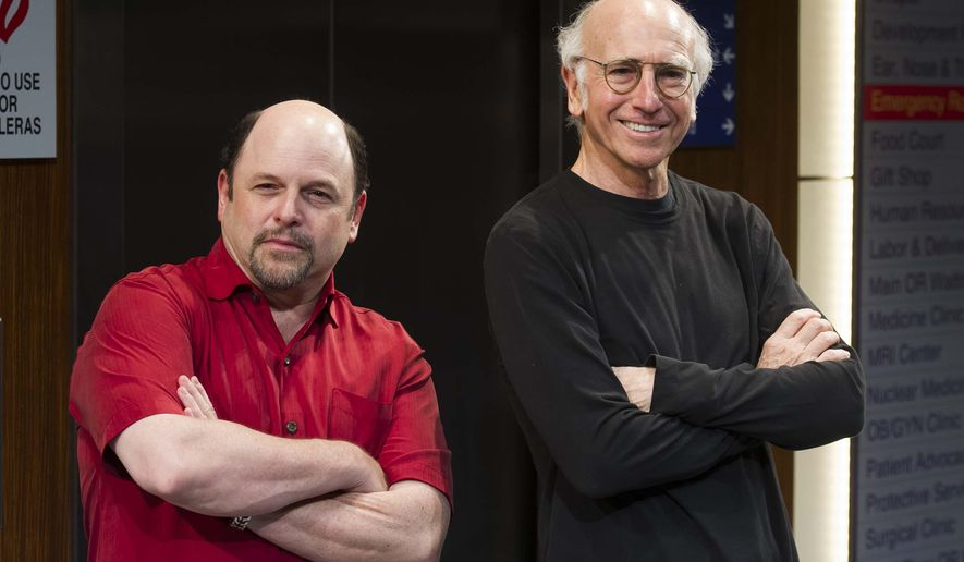"""FILE - In this May 28, 2015 file photo, Jason Alexander, left, and Larry David pose for a photo on the set of """"Fish in The Dark"""" at the Cort Theatre in New York. The play is about the rivalries and still-simmering angers that explode when a family gathers to bid farewell to their dying patriarch. (Photo by Charles Sykes/Invision/AP, File)"""