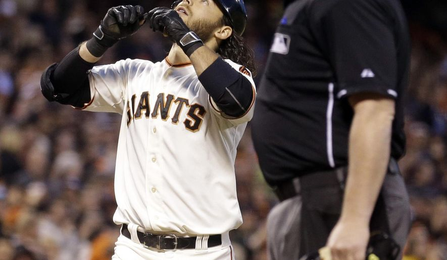 San Francisco Giants' Brandon Crawford celebrates after hitting a two-run home run off Pittsburgh Pirates' A.J. Burnett during the third inning of a baseball game Tuesday, June 2, 2015, in San Francisco. (AP Photo/Ben Margot)