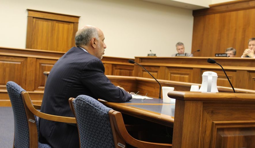 State Treasurer Nick Khouri testifies before the Senate Finance Committee on Wednesday, June 3, 2015 in Lansing, Mich.  The Michigan Senate committee grilled the newly appointed state treasurer in the hearing, but it remains to be seen whether he'll be approved. The Republican-majority Senate Finance Committee questioned  Khouri on issues ranging from how he planned to improve the department to whether he believed his former position with DTE Energy Co. would present a conflict of interest. (Emily Lawler/The Grand Rapids Press via AP) ALL LOCAL TELEVISION OUT; LOCAL TELEVISION INTERNET OUT