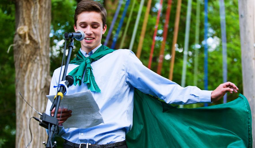 Twin Peak Charter School senior Evan Young reads his valedictorian speech on May 31, 2015 in Boulder, Colo.    The Twin Peaks Charter Academy that barred Young, a gay valedictorian from coming out during his commencement speech denies it discriminated against the teen, but says no discussion of sexual orientation is appropriate for a graduation ceremony.  In a letter released Tuesday, June 2, the school in Longmont announced it was reviewing what happened after U.S. Rep. Jared Polis requested a probe.   (Jonathan Castner/The Daily Camera via AP) NO SALES; MANDATORY CREDIT