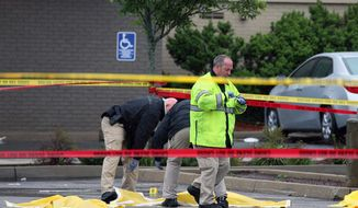 Boston police officers and detectives investigate the scene of a shooting Tuesday, June 2, 2015, in Roslindale, Mass. A man who was under 24-hour surveillance by terrorism investigators was shot and killed after he lunged with a knife at a police officer and an FBI agent outside a pharmacy, authorities said. (Associated Press) ** FILE **