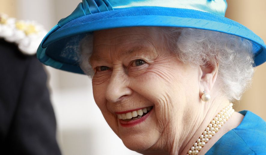 In this Monday, June 23, 2014 file photo, Britain's Queen Elizabeth smiles to the media as she arrives at Hillsborough Castle, Northern Ireland. Buckingham Palace has taken the unusual step of confirming that Queen Elizabeth II went to a hospital for her annual medical checkup after social media comments touched off speculation on her health. The palace said in a statement Wednesday, June 3, 2015 that the 89-year-old monarch attended her annual medical checkup at King Edward VII Hospital in London, and left after the routine exam. (AP Photo/Peter Morrison, File)