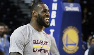 Cleveland Cavaliers' LeBron James smiles during NBA basketball practice, Wednesday, June 3, 2015, in Oakland, Calif. The Golden State Warriors host the Cavaliers in Game 1 of the NBA Finals on Thursday. (AP Photo/Ben Margot)