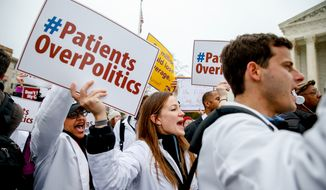 Demonstrators chant during health care rally outside the Supreme Court in Washington on March 4, 2015. The Supreme Court could wipe away health insurance for millions of Americans when it resolves the latest high court fight over President Obama's health overhaul. (Associated Press) **FILE**