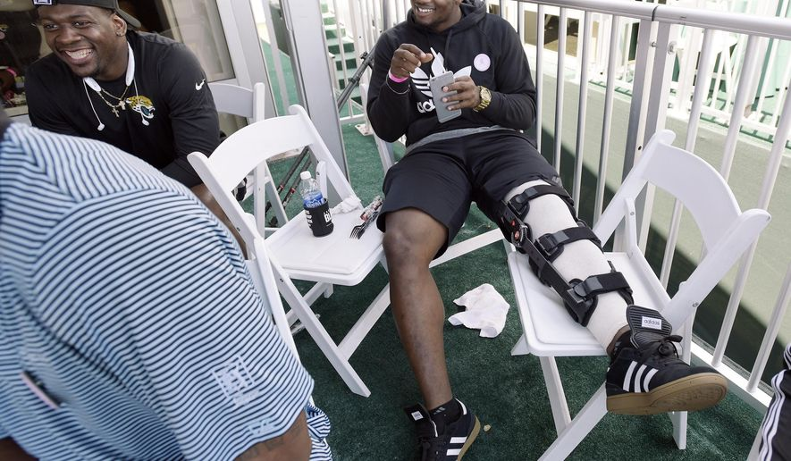 FILE - In this May 10, 2015, file photo, Jacksonville Jaguars first draft pick Dante Fowler Jr. sits with other team rookies in a tent overlooking the 17 green during the final round of The Players Championship golf tournament in Ponte Vedra Beach, Fla. Fowler injured his knee during rookie camp. NFL teams are reviewing the way they handle rookie minicamps after season-ending knee injuries to two prized picks less than a week after all the hugs and handshakes of draft night. (Bob Self/The Florida Times-Union via AP, File)
