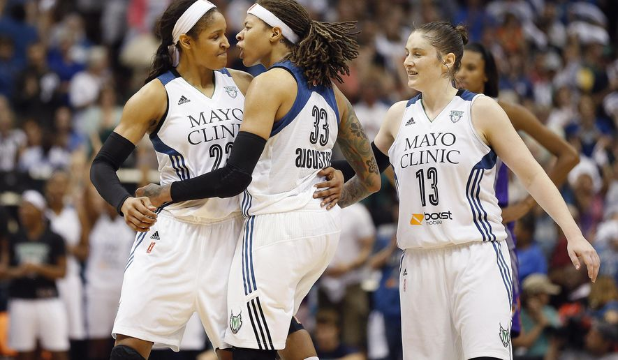 FILE - In this Aug. 31, 2014, file photo, Minnesota Lynx forward Maya Moore (23), guard Seimone Augustus (33) and guard Lindsay Whalen (13) celebrate during the second half of Game 2 of the WNBA basketball Western Conference finals against the Phoenix Mercury in Minneapolis. Last year the Lynx went 25-9 in the regular season while battling various injuries, but fell to the Mercury 2-1 in the conference finals. (AP Photo/Stacy Bengs, File)