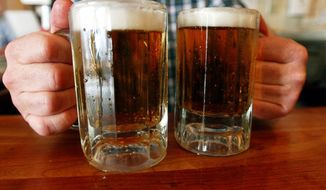 In this June 29, 2004, file photo, a bartender serves two mugs of beer at a tavern in Montpelier, Vt. Alcohol problems affect almost 33 million adults and most have never sought treatment. That's according to a government survey indicating that rates have increased in recent years. (AP Photo/Toby Talbot, File)